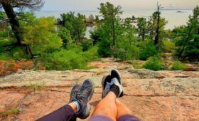 Best Hiking Trails in Ontario - Lounging at Chikanishing Peak